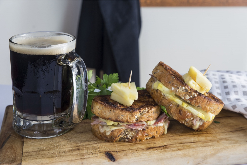 food image with beer and toasted sandwich